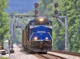 CR 8098 brings a Northbound empty coal train under the endangered signal bridge at Geneva Ky
