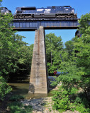 Train 116 crosses the Pittman Creek bridge as crews move a crane into posistion to raise the new span