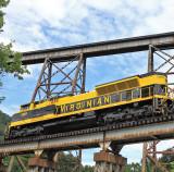 Virginian 1069 crosses Copper Creek, with the massive CRR bridge for a backdrop