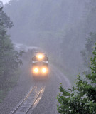 SR 8099 brings train 197 through the cut at Parkers Lake in the middle of a strong storm