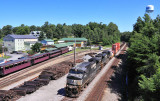 Southbound stacks roll through Stearns as the Big South Fork train sits at the depot