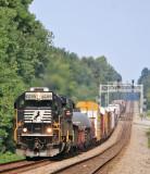 A spartan cab SD60 leads train 117 through the roller coaster profile at Gradison