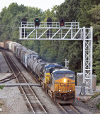 NS 143 at Southern States near Somerset...Ugly CSX power and ugly new signals