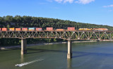 Southern Pacific 1996 brings NS 223 across the Cumberland River bridge on a hot August evening
