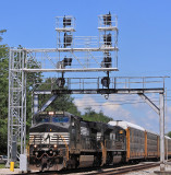The new signals are up (but not yet in service) as train 275 comes South on a hot afternoon