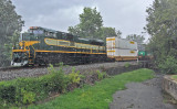 Erie 1068 shoves hard on the bottom of train 23G as they pass through Harrodsburg during an intense summer storm.
