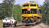 Virginian 1069 passes a track inspector at the East end of Tucker
