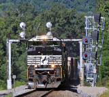 A Southbound manifest passes Two generations of signals and whistle post at Southfork