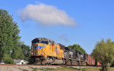 A UP SD70m leads train 167 through downtown Moreland KY on a cool September morning