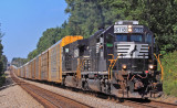 NS 275 flies down the tangent at Gradison with a EMD on the point and over a mile of racks stretched through the dips
