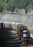 The cut is filled with the sweet music of a hard working EMD as train 275 climbs Kings Mountain