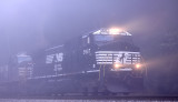 A Southbound grain train appears out of the fog after crossing the Cumberland River at Burnside