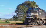 EMD and a John Deere...NS 168 sits at Palm waiting on a meet as a farmer heads for the barn after a long day in the hay.