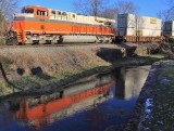Interstate 8105 reflects in the waters of Town Branch creek as it trails train 23G through Harrodsburg