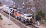 A Southbound grain train comes under the signals at Revilo KY with a set of BNSF power on a cloudy day