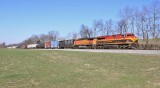 NS 123 eases down the valley near McKinney with a mix of KCS and BNSF power