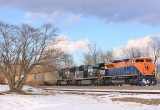 CNJ 1071 grinds out of the KY river valley with a loaded grain train in the last light of a winter day