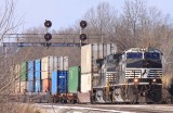 A white faced NS 9786 brings the hot 229 under the signals at Palm
