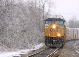 A lone CSX GE drags NS 197 through the ice at Milidgeville