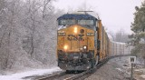 A lone CSX GE drags NS 197 through the ice and snow at Milidgeville