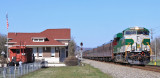 Green & Gold SOUTHERN power once again passes the depot at Spring City with Southbound varnish