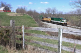 NS 215 passes the barn at Blanchet,  Ky on a fine Spring afternoon
