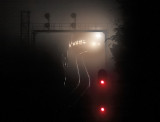 NS 288 lights up the foggy searchligh signals at Kings Mountain before sunrise