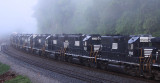 A string of GP38-2's with NS markings painted out, headed back to the leasing company