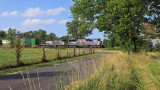Eastbound 285 rolls through the farmland of Mercer County, KY with the Veterans 6920 leading.