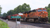 Southbound 167 with BNSF power passes the old depot at Helenwood