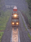 The Sound of a Trio of EMD's in #8 is all but drowned out by the rain as 223 climbs up Kings Mountain