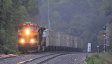 A KCS Belle leads NS 264 by the new signals at MP 165.3 just northof the old CP at Grove