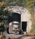 The familiar face of a EMD SD60 pops back into the sunlight at the South end of Tunnel 26