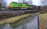 Illinois Terminal 1072 leads NS 27V West along Town Branch creek at Harrodsburg, KY in the last light of a wet day.