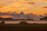 Mist and sunrise over the fields, very early morning, Sweden