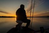 Jonny on his boat at sunrise