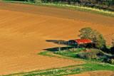Empty barn and ploughed field, near Cadbury (2000)