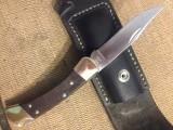 My first folding knife Leather sheath (repurposed saddle bag leather) buck 110