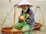 Beach vendor cutting up fruit, Vietnam