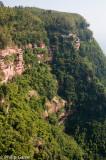 Sandstone cliffs flank a deep gorge