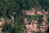 A Buddhist temple clings to the sandstone cliffs of the gorge