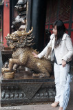 Stroking the bronze lion, Wenshu Monastery