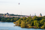 Hot air balloon soaring above Västerbron bridge, with the city centre beyond