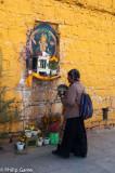Woman worshipping outside the Potala