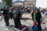 Worshippers prostrate themselves at the Jokhang Temple, Lhasa