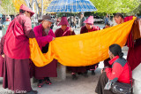 Monks unfurling a banner, Lhasa