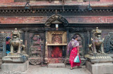 Woman at a shrine to the demon god Bhairab
