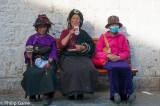 Pilgrims resting below the Potala Palace, Tibet