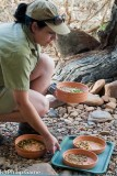 Setting out feeding bowls at Alice Springs Desert Park