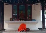 Buddhist monk at prayer, Kandy
